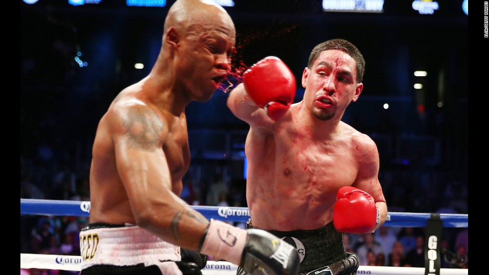 Danny Garcia punches Zab Judah during the WBA Super and WBC Super Lightweight title fight at Barclays Center in Brooklyn, New York, on April 27. Garcia was declared the winner after 12 rounds.