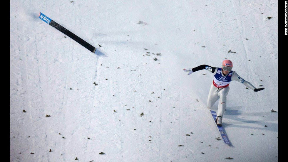 Manuel Fettner of Austria loses a ski after landing during the ski jumping large hill team competition at the FIS Nordic Skiing World Championships on March 2 in Predazzo, Italy.