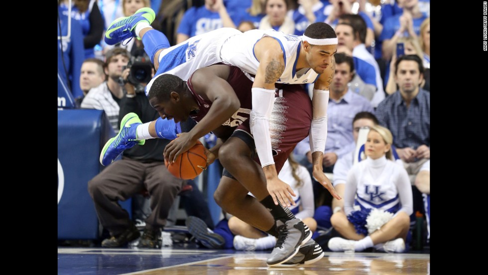 Willie Cauley-Stein of the Kentucky Wildcats lands on Gavin Ware of the Mississippi State Bulldogs during a game at Rupp Arena in Lexington, Kentucky, on February 27. Kentucky won 85-55.