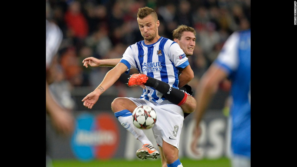 Real Sociedad's Haris Seferovic, front, and Bayer Leverkusen's Stefan Reinartz challenge for the ball during a Champions League Group A soccer match on October 2 in Leverkusen, Germany.