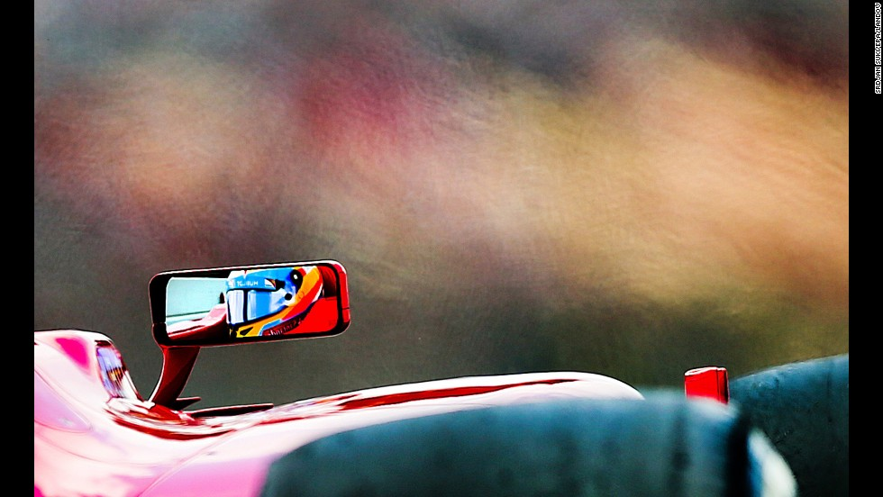 Spanish Formula One driver Fernando Alonso of Scuderia Ferrari is reflected in the mirror on May 11 during the third practice session at the Circuit de Catalunya in Montmelo near Barcelona.