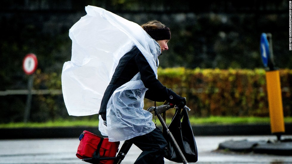 A woman fights the wind as she cycles in Amsterdam, Netherlands, on December 5.