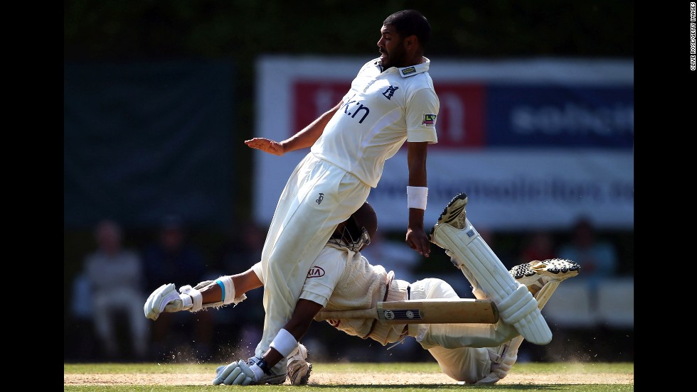 Arun Harinath of Surrey collides headfirst with Jeetan Patel of Warwickshire during Day 3 of their LV County Championship Division One match in Guildford, England, on June 7.