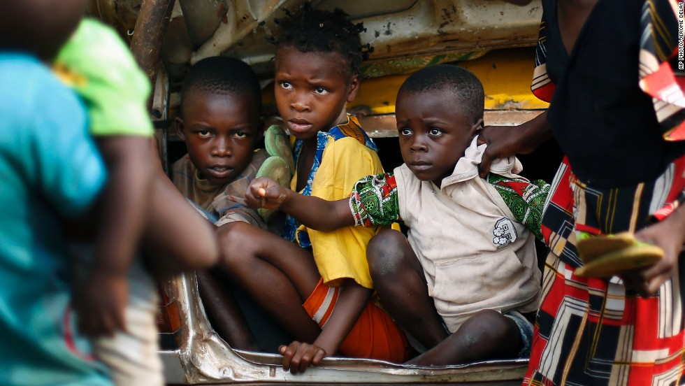 "DECEMBER 5 - BOUEBOU, CENTRAL AFRICAN REPUBLIC: Christian children are packed in the trunk of a taxi to be protected from sectarian conflicts in their country. The U.N. security council meets today to discuss the deployment of international troops in order to protect civilians. Experts believe this ""<a href=""http://www.cnn.com/2013/12/02/opinion/central-african-republic-melly/index.html"">could save the C.A.R. from becoming the next Rwanda</a>."""