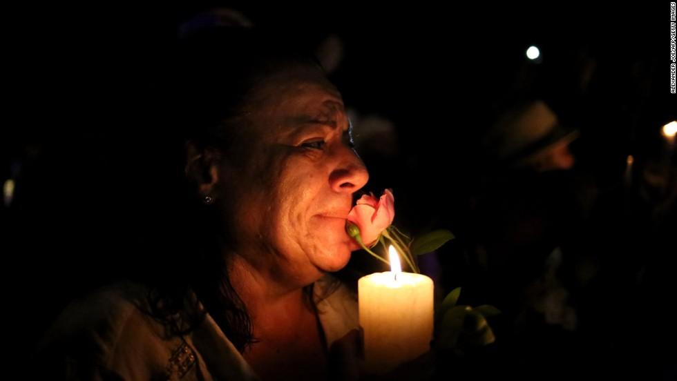 A woman cries outside Mandela's house in Johannesburg after Mandela's death on Thursday, December 5.