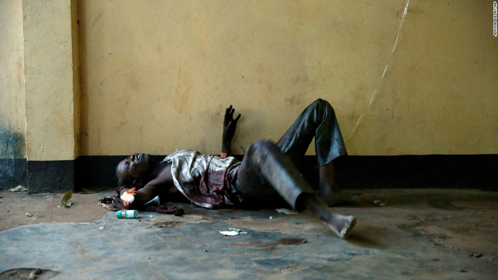 A severely wounded man lies unattended in a Bangui mosque December 5.