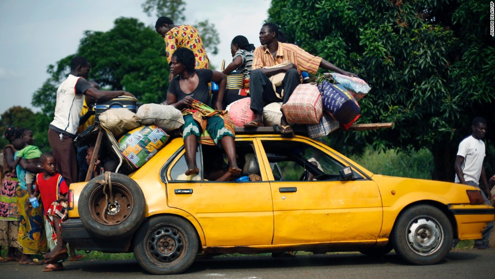 Christians from the village of Bouebou load up on a taxi as they flee violence on December 4.