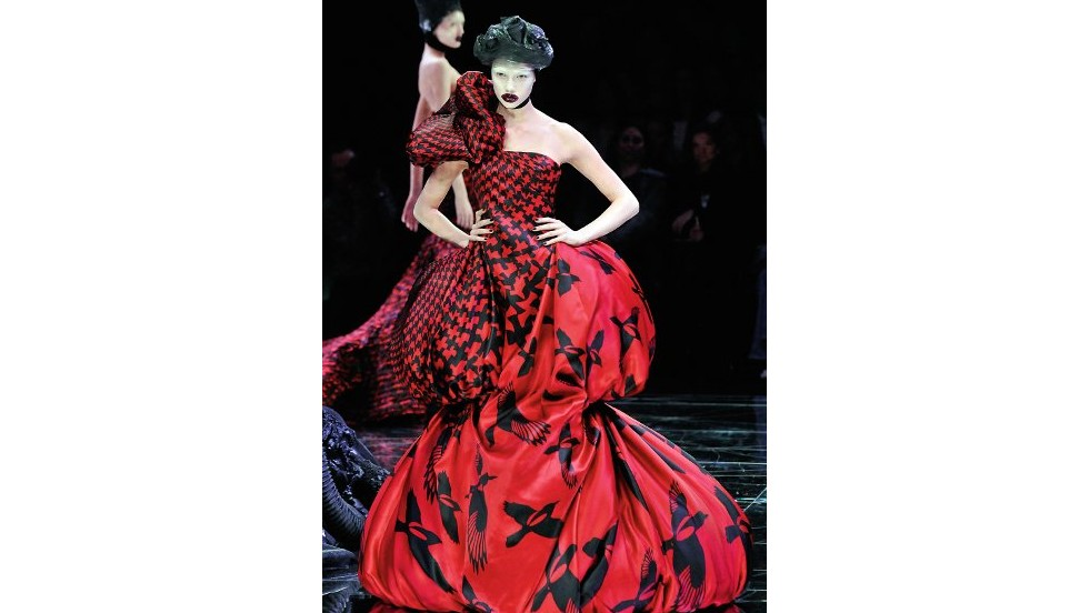 Even before high-profile showings at art fairs, designers have been drawing inspiration from and collaborated with artists for years.  Alexander McQueen's theatrical runway shows blended art, music and film where viewers experienced far more than just a fashion presentation. Here, a model walks down the catwalk in a 2009 show in Paris.