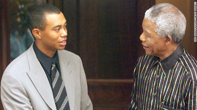 A youthful Tiger Woods meets Nelson Mandela for the first time in 1998 shortly after winning the U.S. Masters.