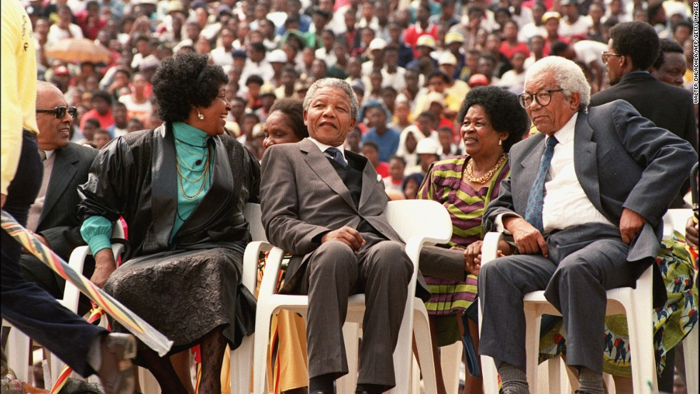 Walter Sisulu (right) is among the most respected leaders of the freedom movement in South Africa. The former ANC secretary-general was, like Mandela, jailed at Robben Island, where he served more than 25 years. In this photo, Sisulu is seated with Nelson Mandela (c), his then-wife Winnie (l), and Sisulu's wife Albertina (2nd-r), at a rally to celebrate Mandela's release from jail in 1990.