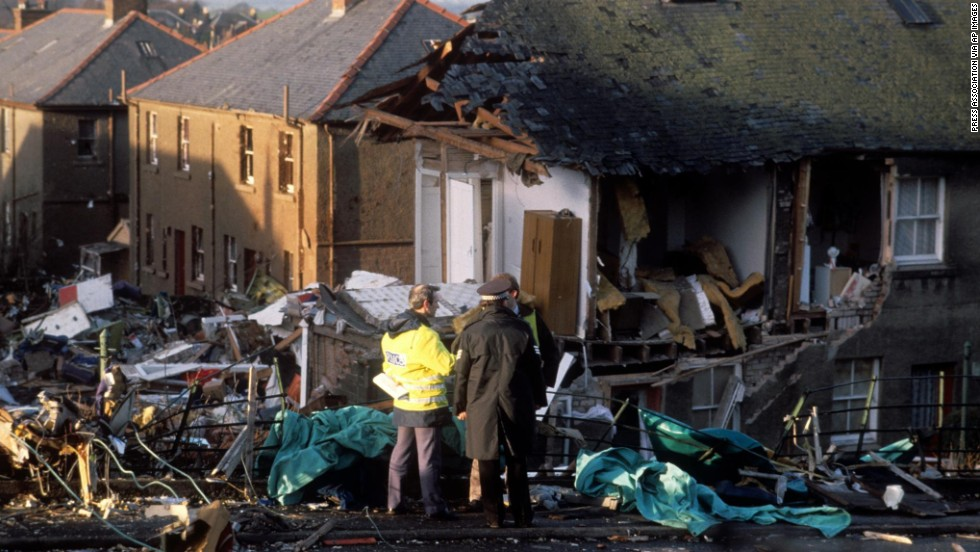 Investigators confer at the crash site two days after the tragedy. In July 1990, the British Civil Aviation Authority's Air Investigation Branch officially reported that an explosive device caused the crash.