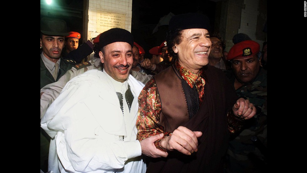 Fhimah, left, walks with Libyan leader Moammar Gadhafi in Tripoli on February 1, 2001, a day after being acquitted.