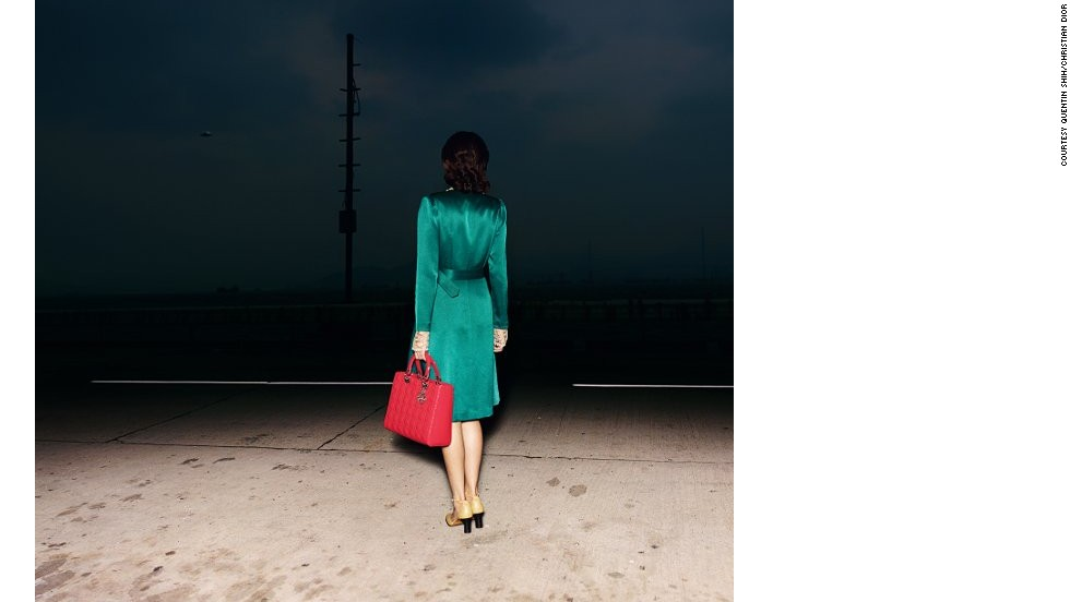 Quentin Shih became something of a regular contributor to the house of Dior, and also took this mysterious image titled <em>A Chinese Woman with a Lady Dior Handbag</em> in 2011.