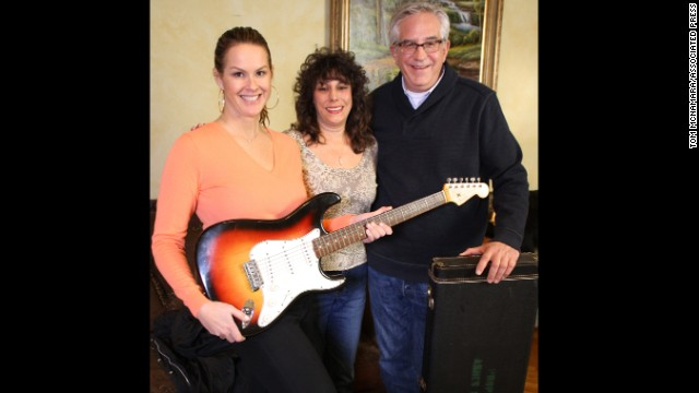 "Dawn Peterson, center, appears with ""History Dectives"" Elyse Luray and Wes Cowan.  Peterson brought the guitar to the to PBS show ""History Detectives"" for authentication."