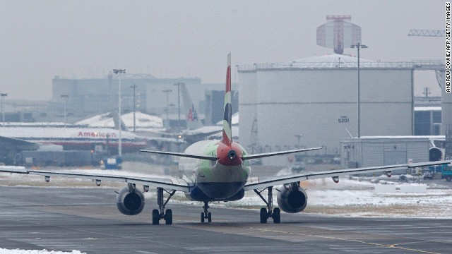 A British Airways plane taxis on the runway at Heathrow airport in west London on January 21, 2013.