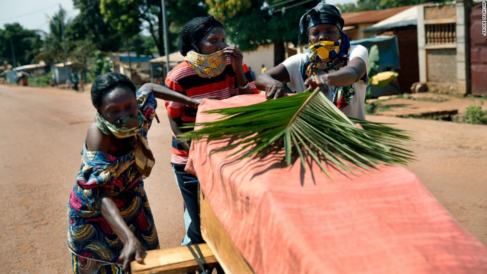 Women push a coffin in the streets of Bangui on December 7. Violence has raged in the Central African Republic since a coalition of rebels deposed President Francois Bozize in March, the latest in a series of coups since the nation gained independence.