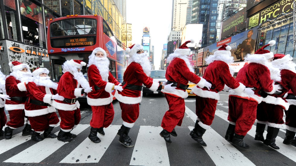 Santa Clauses bunny-hop through Times Square as they deliver holiday Peeps and spread cheer on December 4.
