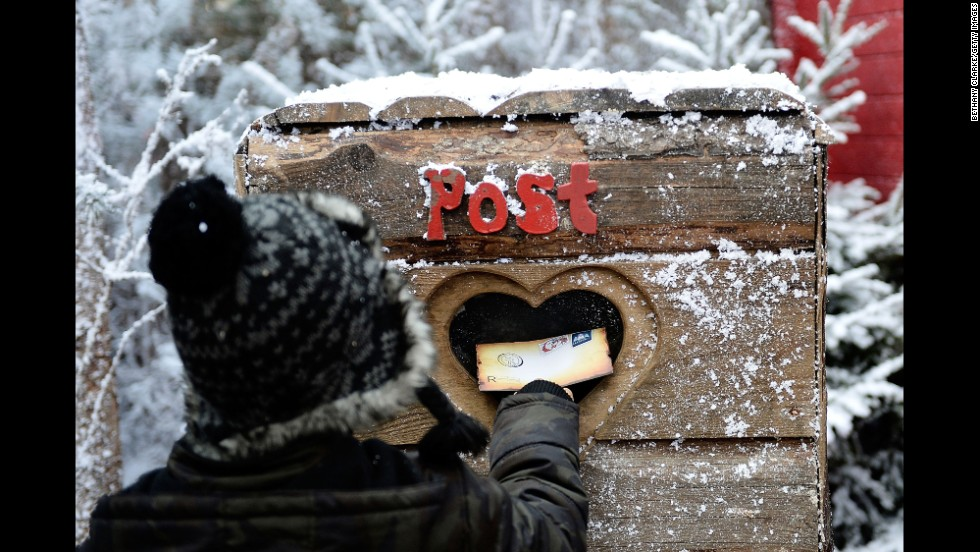 A child posts a letter to Santa in the Elf Village in Ascot, England, on November 30. LaplandUK opened its doors at its new location in Ascot, offering a Christmas experience set in a snow-covered forest with real huskies, reindeer and Father Christmas himself.