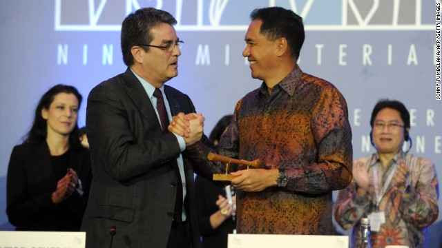 Indonesia's Trade Minister Gita Wirjawan (R) shakes hands with WTO Director General Roberto Azevedo (L) after the final agreement before the closing ceremony of the WTO (World Trade Organisation) conference in Nusa Dua, on Indonesian resort island of Bali on December 7, 2013. AFP PHOTO/Sonny Tumbelaka (Photo credit should read SONNY TUMBELAKA/AFP/Getty Images)