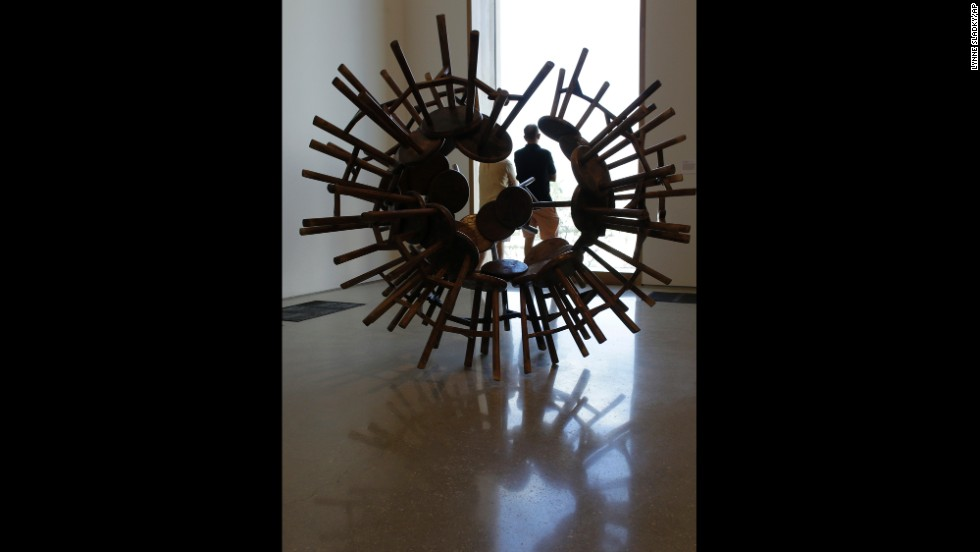 "A sculpture by the Chinese artist Ai Weiwei, titled ""Grapes,"" features 40 antique wooden stools from the Qing Dynasty, and is on display  at the Perez Art Museum Miami on December 7."