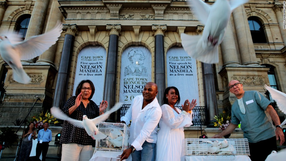 Doves are released for Mandela at the Grand Parade in Cape Town, South Africa, on December 8.