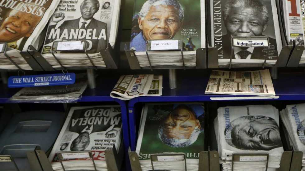 Newspapers with Mandela on the front page are on sale in London on December 6.