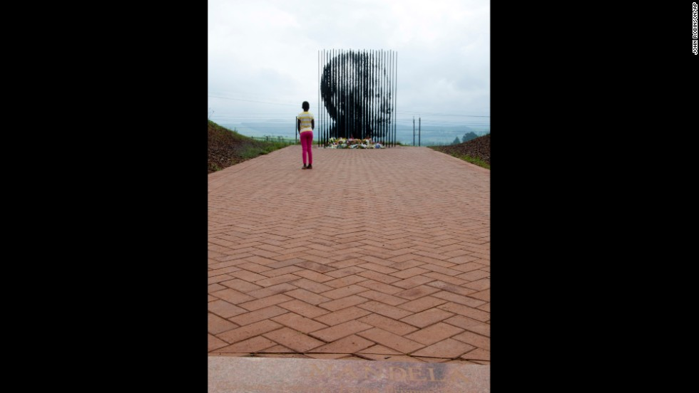 A child checks out at a sculpture of Mandela by Marco Cianfanelli near Howick, South Africa, on December 9.