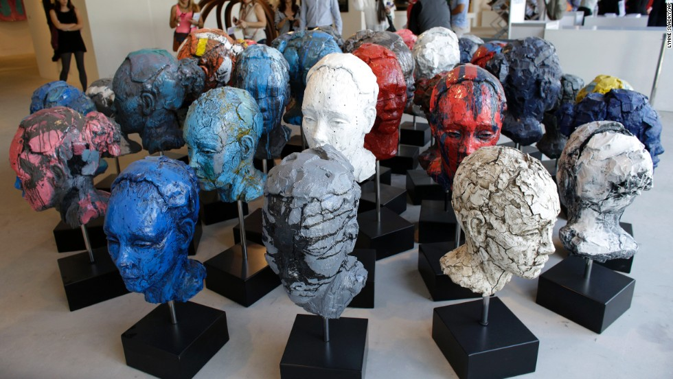 "An installation of 40 heads made of cast resin by artist Lionel Smit titled ""Accumulation of Disorder"" is displayed at Art Miami,  December 8. Art Miami is one of numerous satellite fairs that run in conjunction with Art Basel."