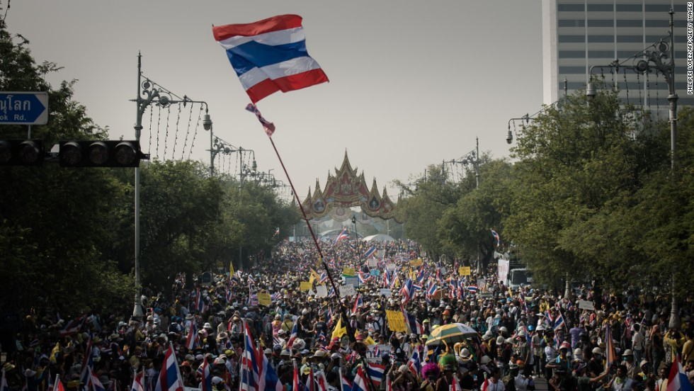 Demonstrators march towards government buildings in Bangkok on December 9 even after Thailand's PM, Yingluck Shinawatra, called a snap election in attempts to defuse the kingdom's political crisis.