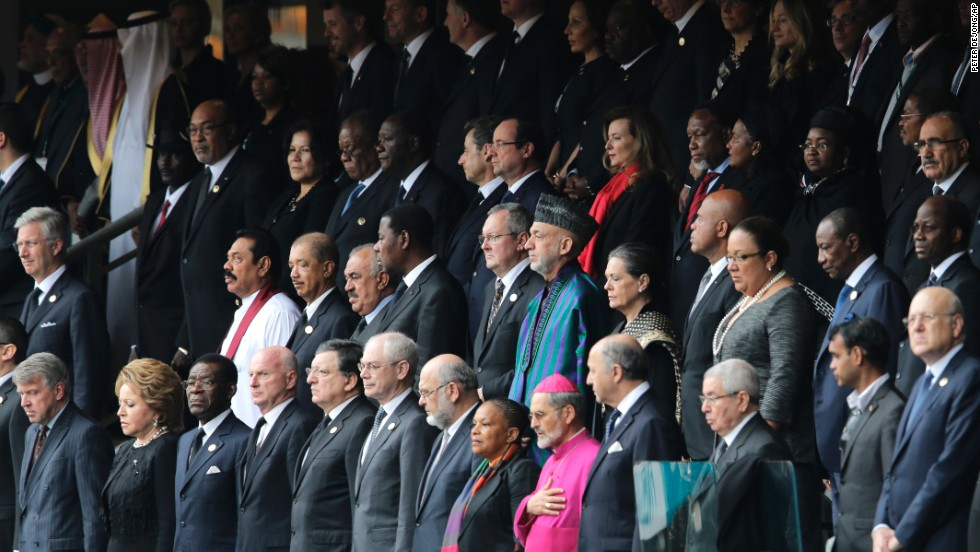 Dignitaries from all over the world stand at the beginning of the memorial service.
