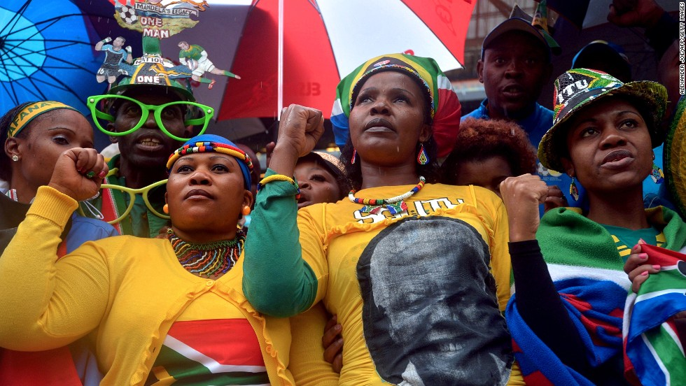 "DECEMBER 10 - JOHANNESBURG, SOUTH AFRICA: <a href=""http://cnn.com/2013/12/10/world/africa/nelson-mandela-memorial/index.html?hpt=hp_t1"">Presidents, prime ministers, celebrities and royals joined tens of thousands of South Africans</a> at the Soccer City Stadium to pay tribute to Nelson Mandela Tuesday, in a memorial service celebrating a man seen as a global symbol of reconciliation."