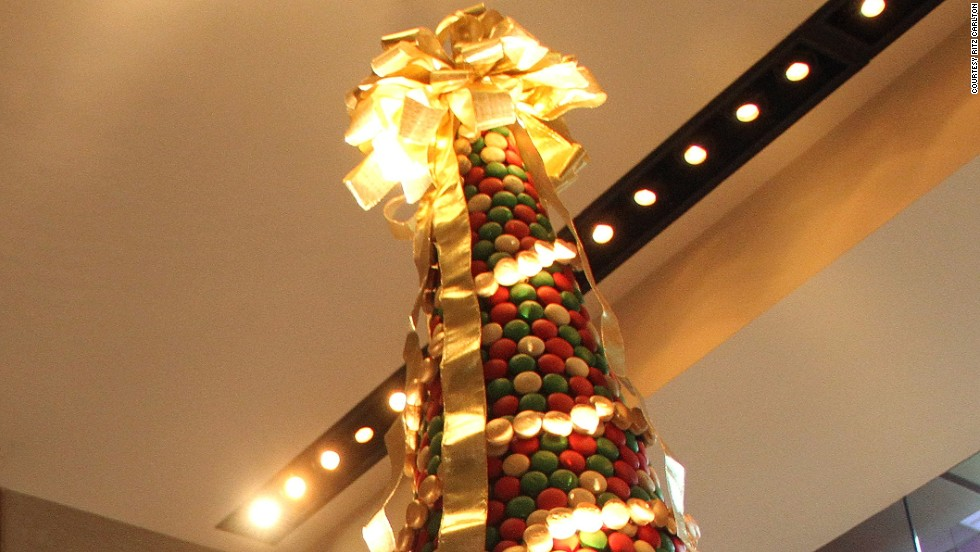 The hotel pastry team at the Ritz-Carlton hotel in Charlotte, North Carolina, took 58 hours to create this 8,000-cakelet Christmas tree. And were paid in macaroons.