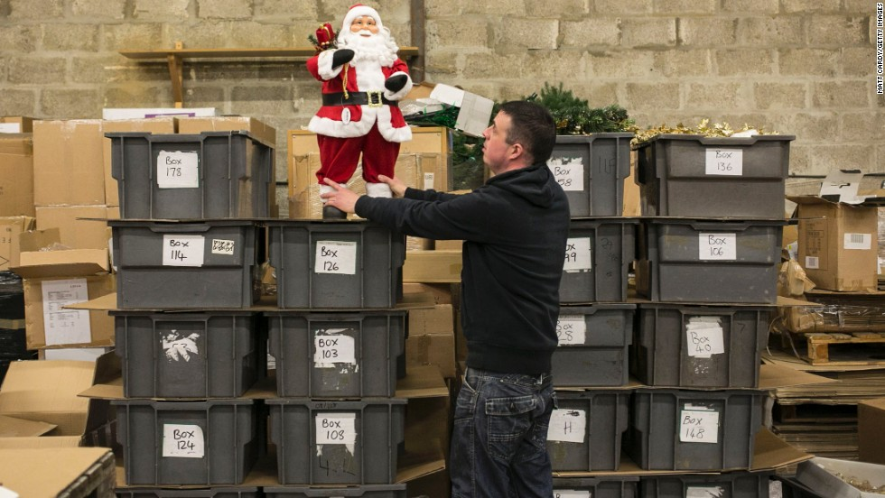 Stuart Baillieul, an employee with Festive Productions Ltd., selects decorations to be sold by retailers at retail shows.