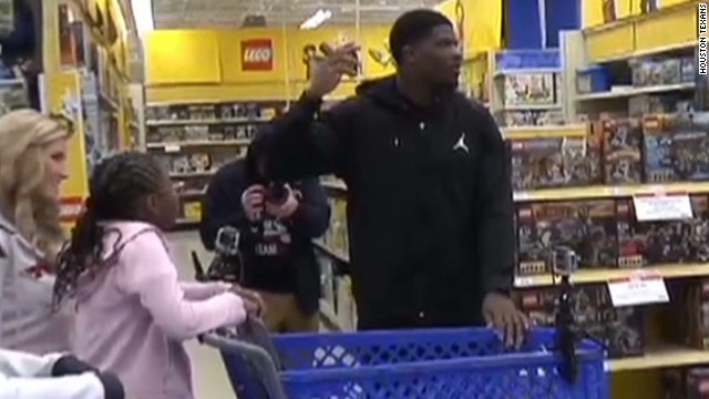 2013: Andre Johnson gives kids $17k in toys