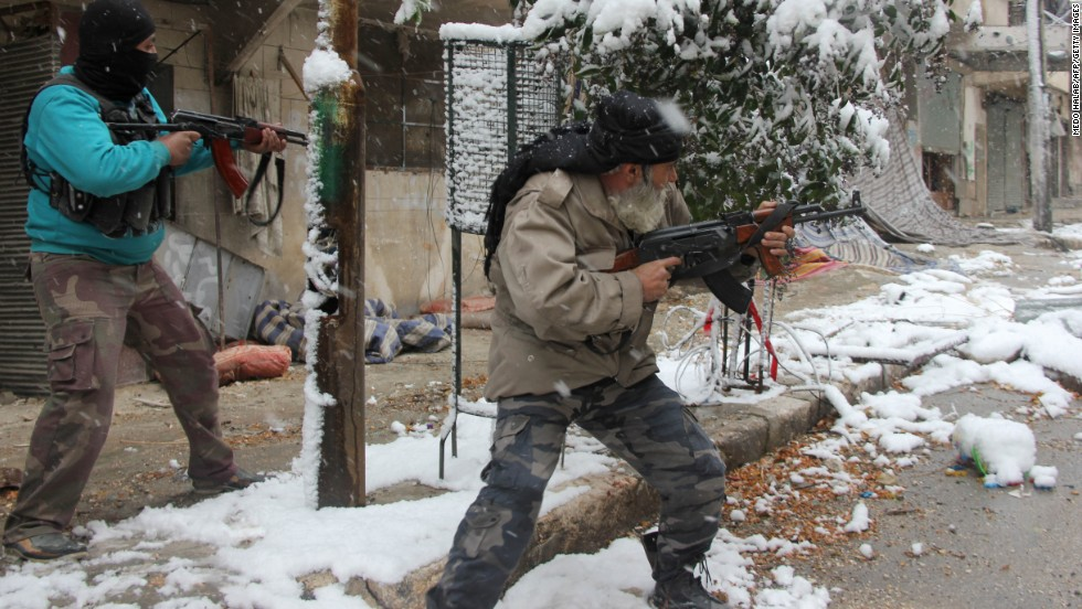 Syrian rebel fighters clash with pro-government forces in Aleppo on Wednesday, December 11.