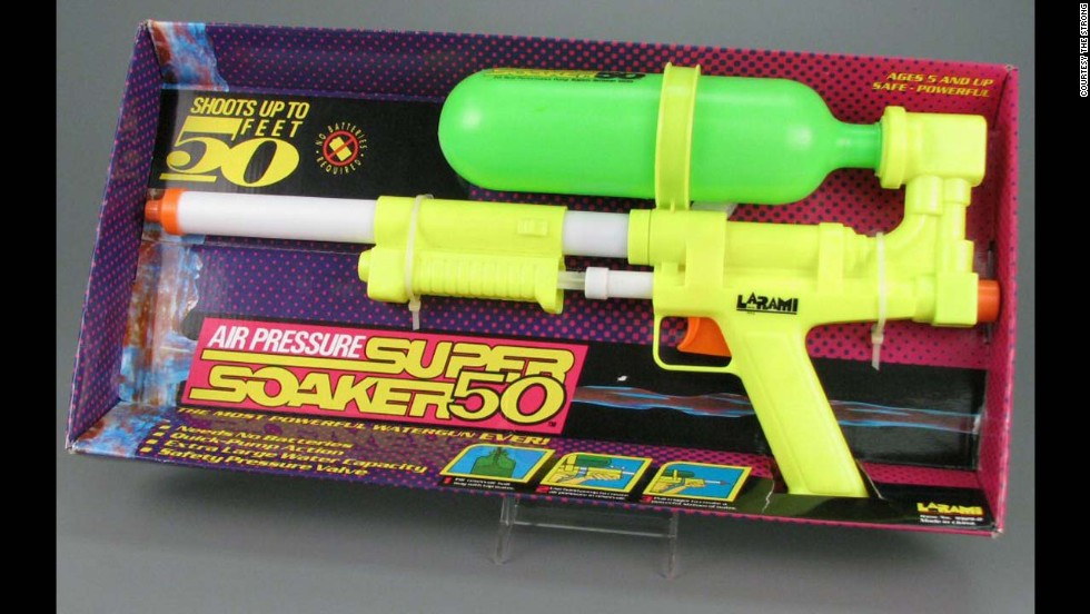 "Super Soaker 50 water pistol by Larami Corp. in 1990. The year was 1989, children were still throwing around archaic water balloons until Dr. Lonnie Johnson, a nuclear engineer came up with the idea of a high powered toy water gun. Originally called the ""Power Drencher,"" Johnson started a whole new era of backyard water fights. The Super Soaker 50 didn't require batteries, and was one of the most powerful water guns on the market."