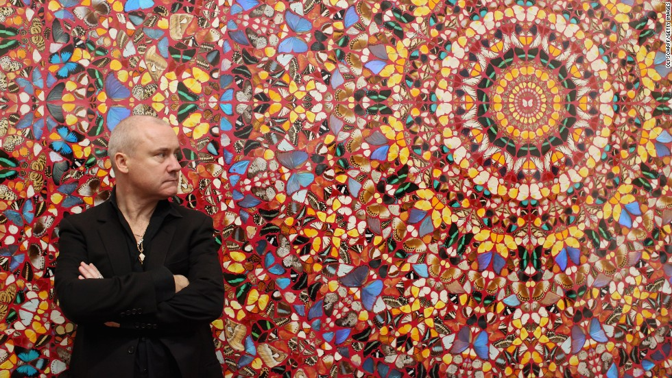 "Hirst, possing in front of his artwork ""I am Become Death, Shatterer of Worlds"" at London's Tate Modern on April 2, 2012, rose to fame in the 1990s as one of the Young British Artists, or YBAs, along with Tracey Emin, Sarah Lucas and Jake and Dinos Chapman."