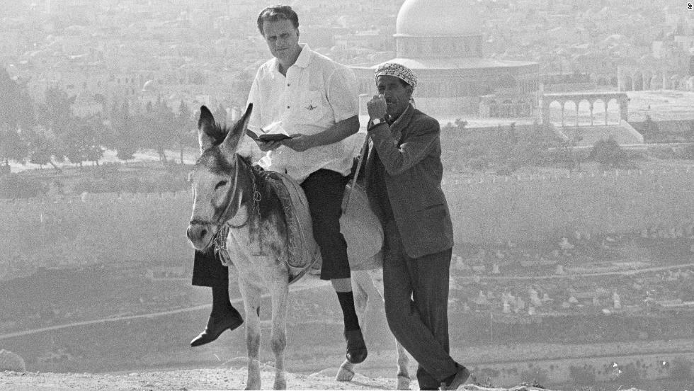 Graham rides a donkey in Jerusalem on March 28, 1969, during a visit to holy places in the city.