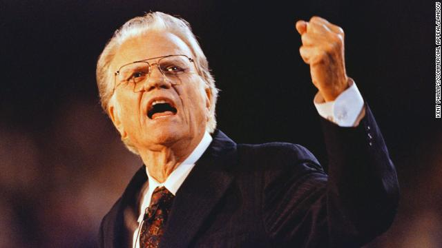 Graham gestures during his message to the capacity crowd at Ericsson Stadium in Charlotte, North Carolina, on September 27, 1996.