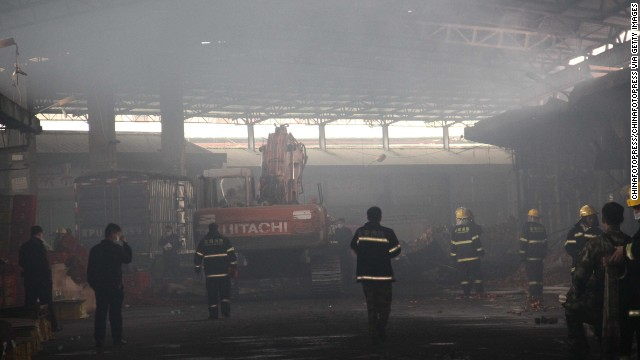 Firefighters search for survivors at a farm produce wholesale market after a fire on Wednesday in Shenzhen, China.