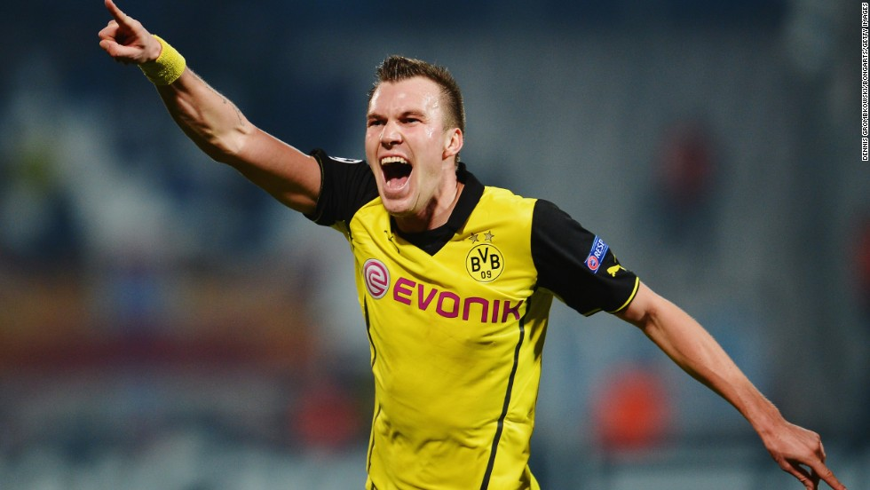 Kevin Grosskreutz scored a late goal for Borussia Dortmund against Marseille to give the German side a vital win in Champions League Group F. The 2-1 victory coupled with Arsenal's 2-0 loss against Napoli means last year's beaten finalists finish top of the group.