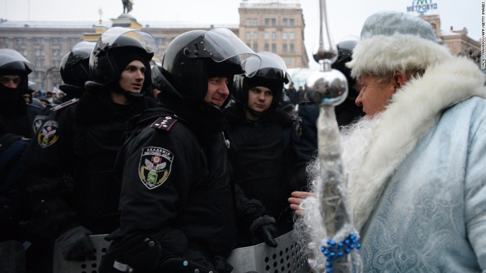 A man dressed as Santa Claus addresses riot police on Independence Square in Kiev, Ukraine, on Wednesday, December 11.
