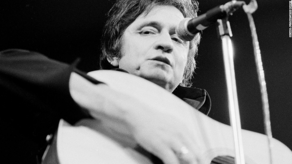 Johnny Cash performs at the Royal Albert Hall in London in September 1972. Click through the gallery to see photos from Cash's life and career.