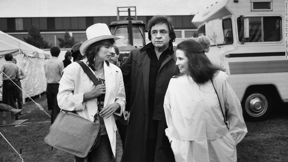 Emmylou Harris, from left, Johnny Cash and June Carter Cash chat at the Farm Aid Concert in Illinois in 1985.