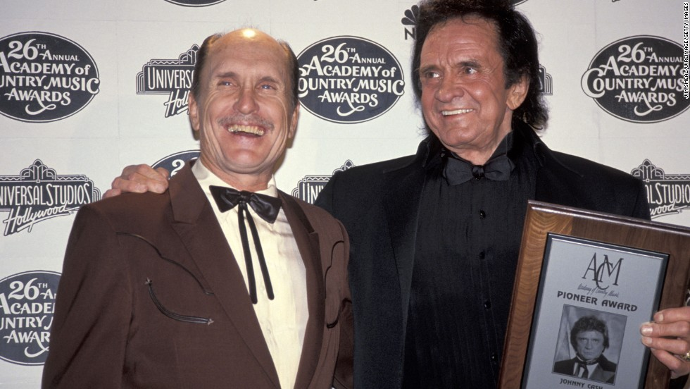 Robert Duvall, left, appears with Johnny Cash during the 26th annual Academy of Country Music Awards in Universal City, California, in 1991.