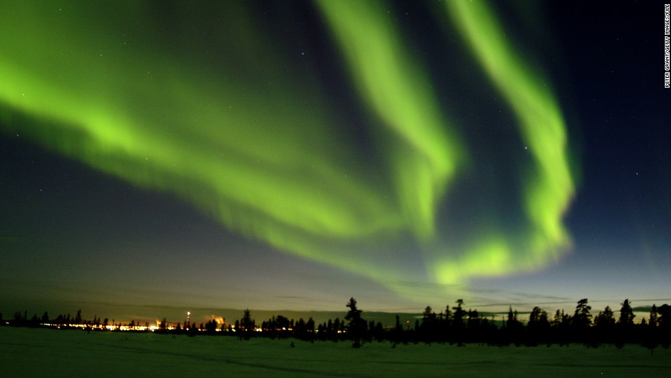 The seasonal interplay of light and darkness is never more spectacular than with the aurora borealis, or northern lights. Jukkasjarvi, Sweden, is a prime spot for viewing the natural light show and welcoming longer days.
