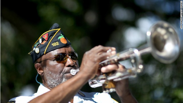 Cyril Bullard, retired from the U.S. Army, plays the trumpet at a Veterans Day ceremony last month in Florida.