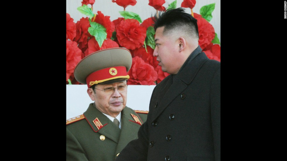 Kim Jong Un walks past his uncle after reviewing a parade of thousands of soldiers commemorating the 70th birthday of the late Kim Jong Il in Pyongyang on February 16, 2012.