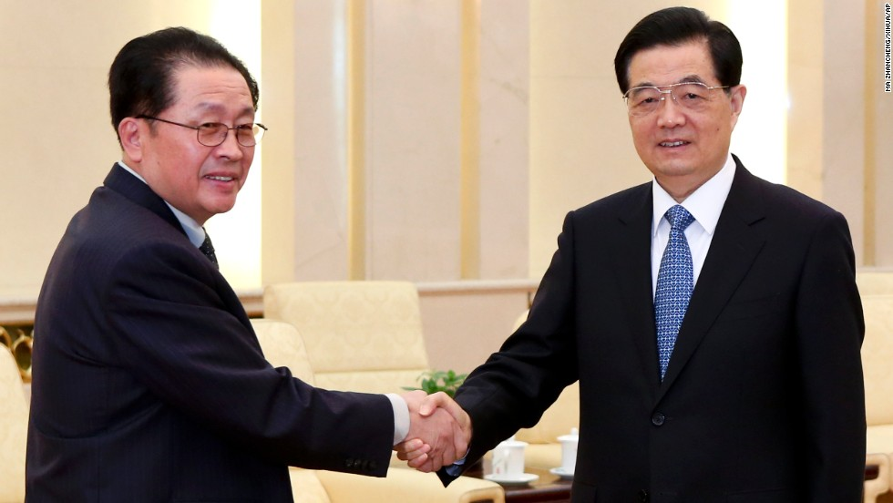 Chinese President Hu Jintao, right, greets Jang in Beijing on August 17, 2012. Jang met China's President and Premier in an effort to improve the relations between the two countries after Kim Jong Un irked Beijing with a rocket launch soon after taking power.