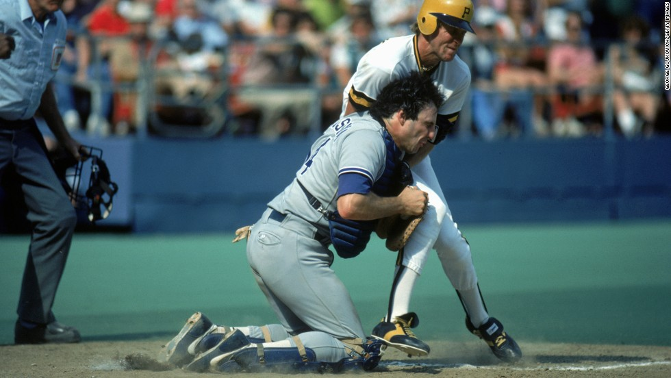 Catcher Mike Scioscia of the Los Angeles Dodgers collides with Joe Orsulak of the Pittsburgh Pirates as he crosses home plate during a 1985 season game in Pittsburgh.
